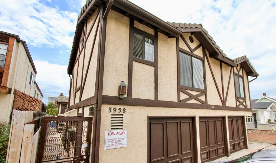 Two story residential buildings with attached garages at Louisiana Heights in North Park California