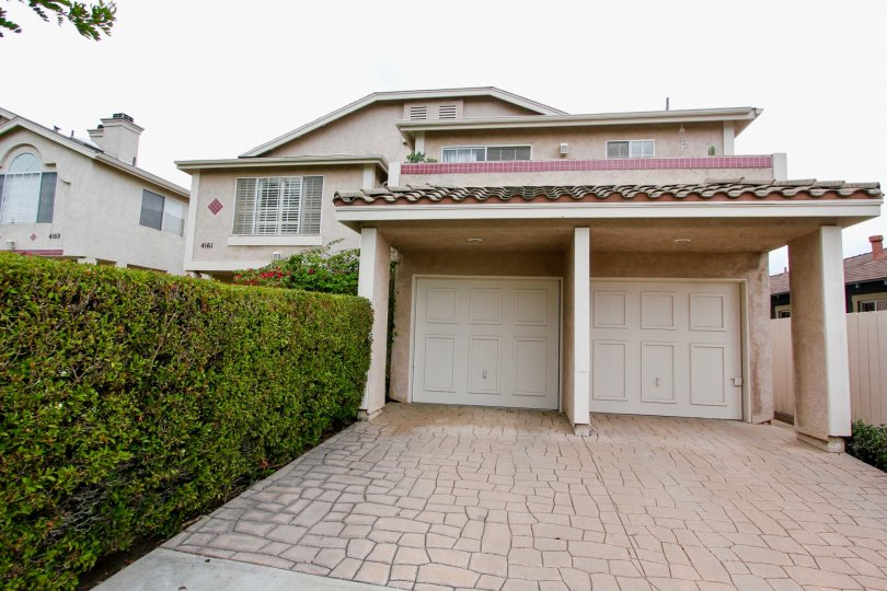 Housing with attached garages and driveway at Mardi Gras Villas in North Park California