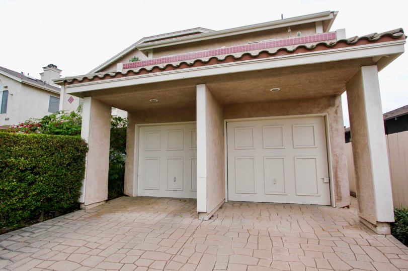 Lovely home is Mardi Gras Villas with custom drive way in North Park California