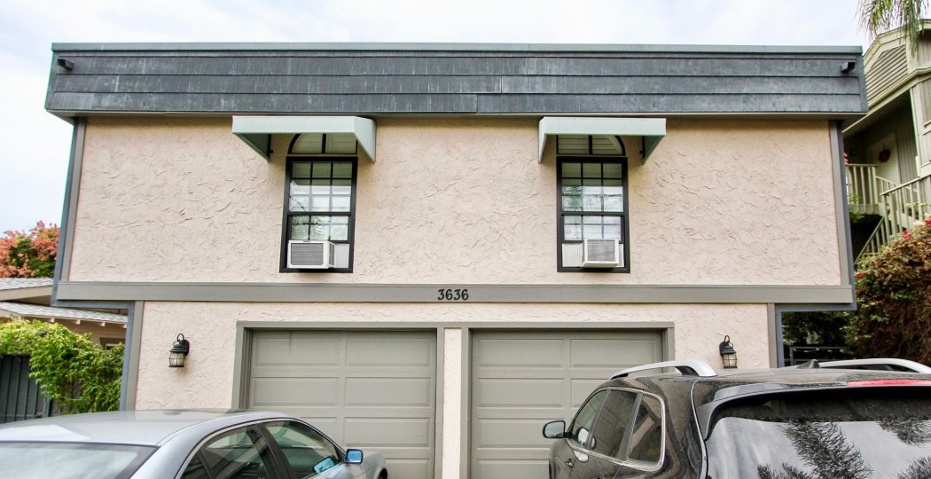 Front of house with two garage doors in bottom level in the Morley Field Townhomes