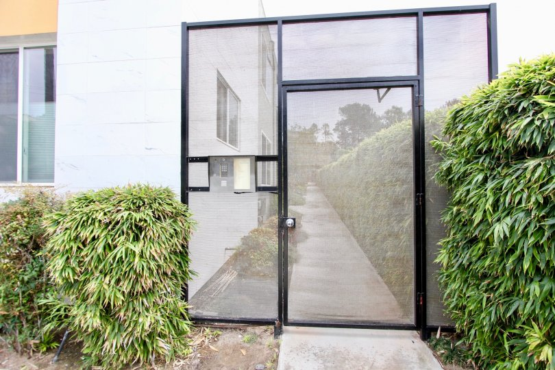 On Florida  , North Park ,: California,black border,shrubs,transparent door