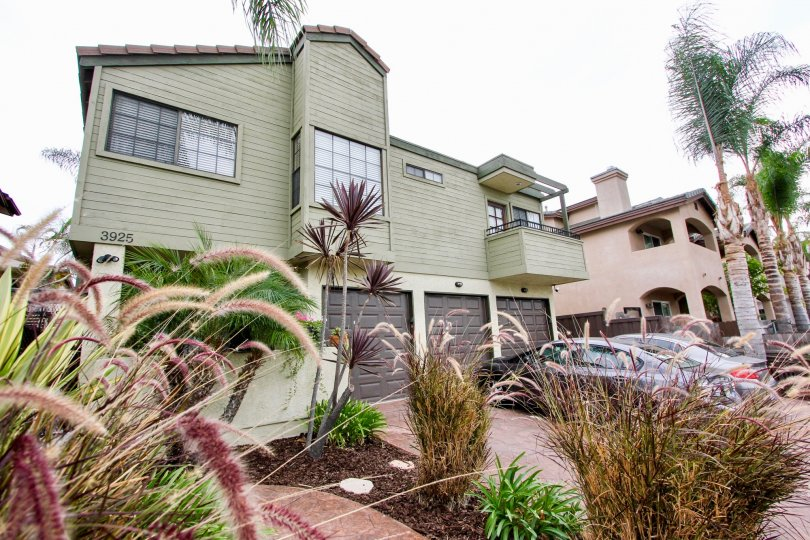 Oregon Street community North Park California decorative grass landscaping garage off street parking balcony tile roof large windows palm trees