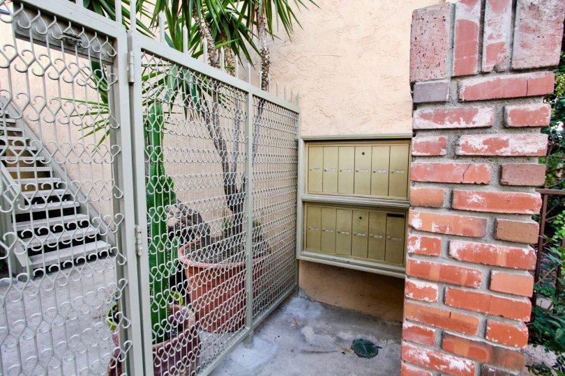 Retro brick walls against tall decorative gates at Park Balboa in North Park, CA
