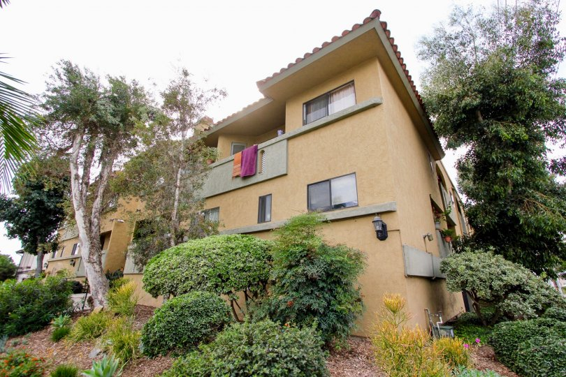 A sunny day in the area of Spanish Oaks I, condos, car, parking area, garage, stairs, towels