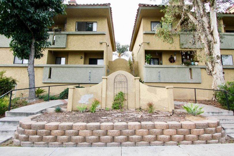 The decorative front garden of an apartment complex in the Spanish Oaks II neighborhood in North Park, California.