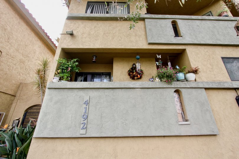 Front of a residence with balconies and little plants in the Spanish Oaks II