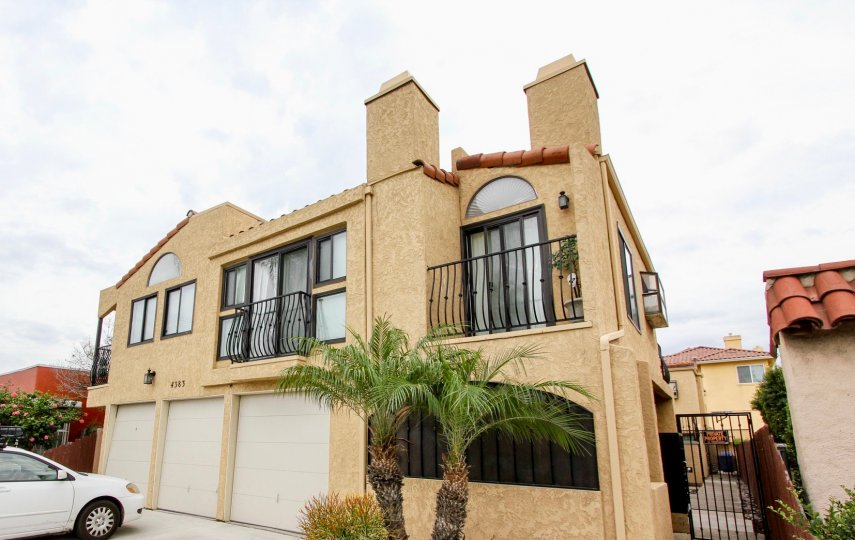 Large, beautifully built Spanish style home in North Park California with palm trees