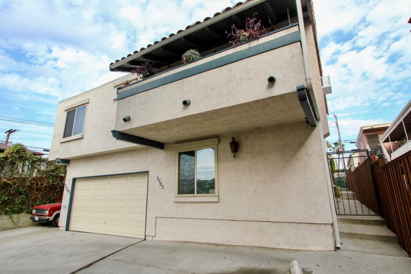 Balcony garden overlooking single garage home with a privacy fence at address 3783