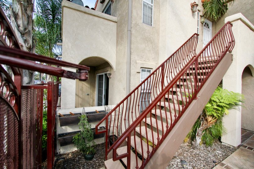 Side view of red stairs leading up to a home in Swift Park community in North Park, California