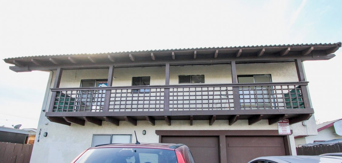 A large balcony of a cream colored unit, 3814, located in Triton Condos of North Park, California