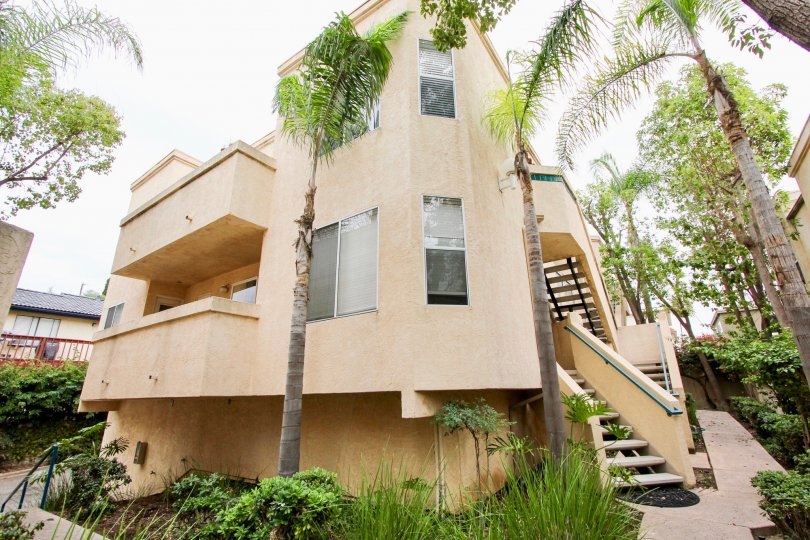 Uptown Villas community North Park California palm trees decorative grass landscaping stairs covered porch balcony windows garden