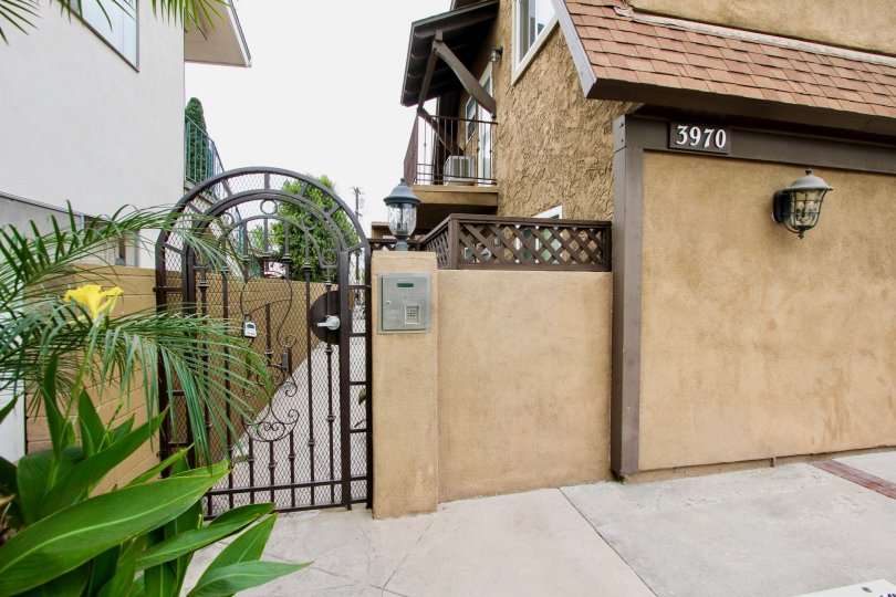 Unique brown aptarment, 3970 address with gated entrance to home