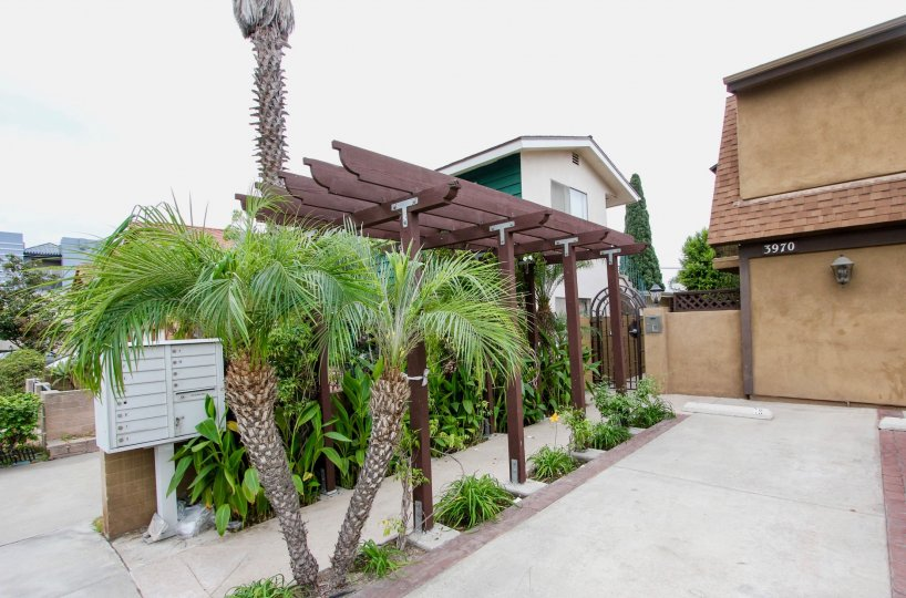 Utah Street Condos in North Park, California bring peaceful nature to you as you walk underneath a wooden awning surrounded by plants to get to your humble abode.