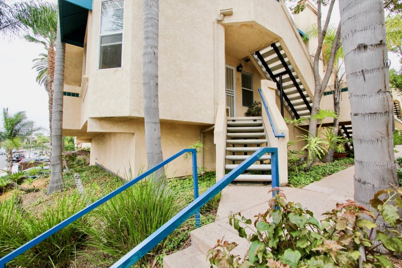 A stairway entrance and outside view of an apartment complex in Villa Del Rio neighborhood in North Park, California