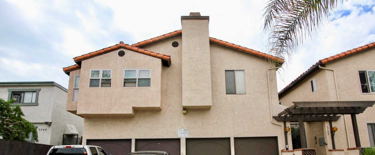 Outside view of a cream colored unit with a chimney located in Villa Park of North Park, California