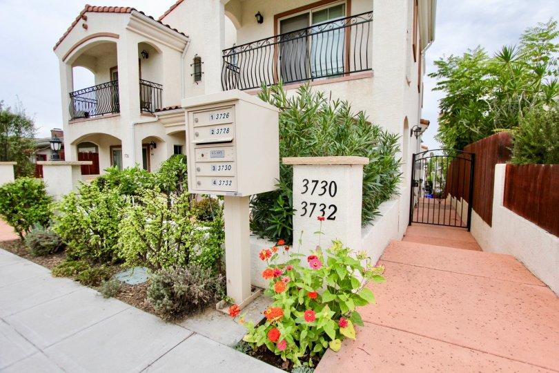 Beautiful landscaping and mailboxes at Villas de Mediterranean in North Park, California