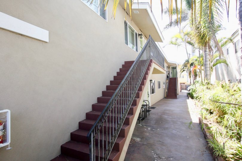 Outside stairs leading to the second floor on an alley between two buildings at 4841 Del Monte Ave.