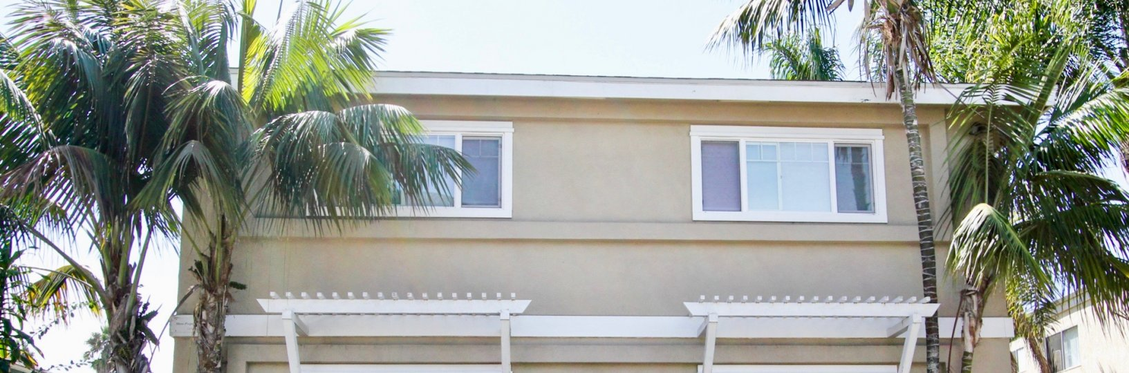 Beautiful and scenic homes surrounded by stately palms at 4841 Del Monte Ave, Ocean Beach, California