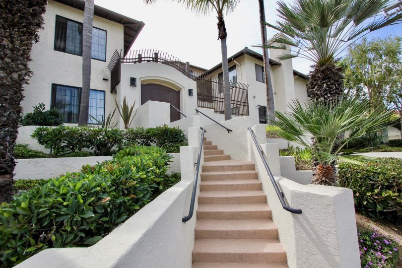 Large two-story house with gate and winiding stairs, located in Famosa Terrace, Ocean Beach, California.