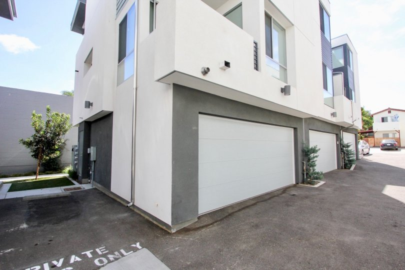 Private garages at Famosa Townhomes in Ocean Beach, California.