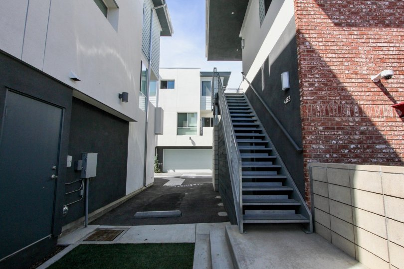 A view of the stairs and back building can be seen at the Famosa Townhomes in Oceanbeach, CA.