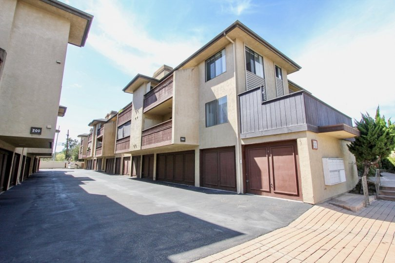 Well maintained backlane with double and single car garage units at Harbor Villas
