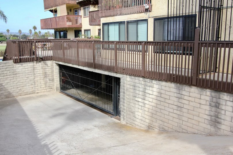 An underground parking to townhouses in the Loma Pacific community with brown terraces.