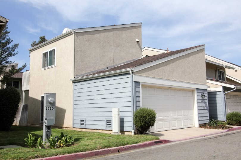 A slanted structured home is on the corner in Park Point Loma an Ocean Beach, CA community.