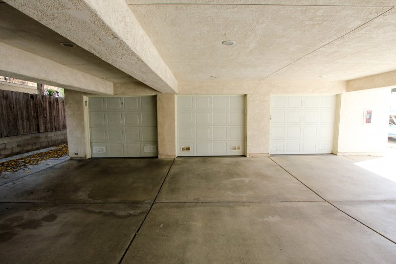 Large 3-door parking garage, open on the sides, located in Poinsettia Villas, Ocean Beach, California.
