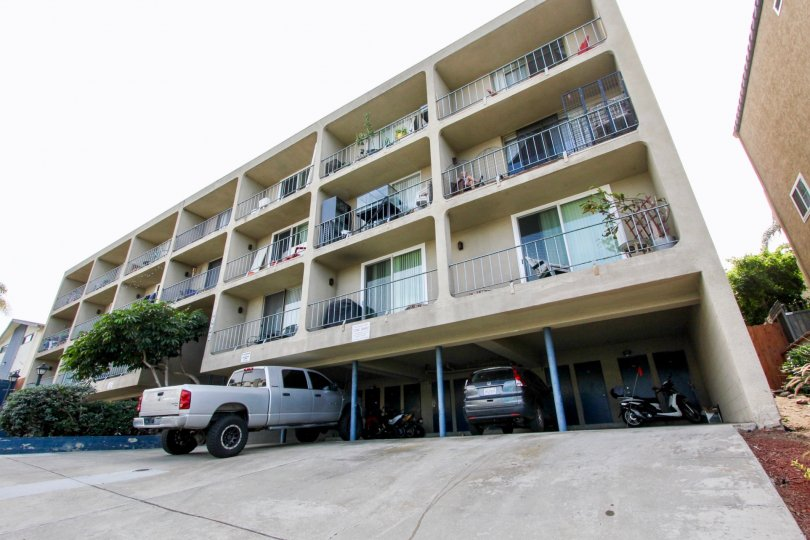 A three story residential building with built in parking in Sans Soucia at Ocean Beach CA