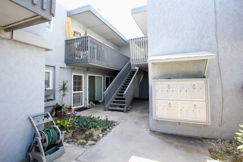 Private courtyard with mailboxes and a small garden with balconies in Ocean Beach
