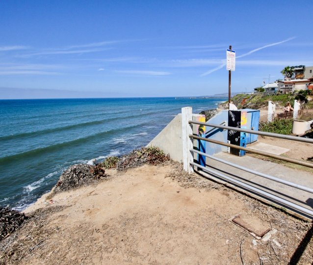 Dirt area overlooking the ocean, beside homes and gates, located at Sunset Towers, Ocean Beach, California.