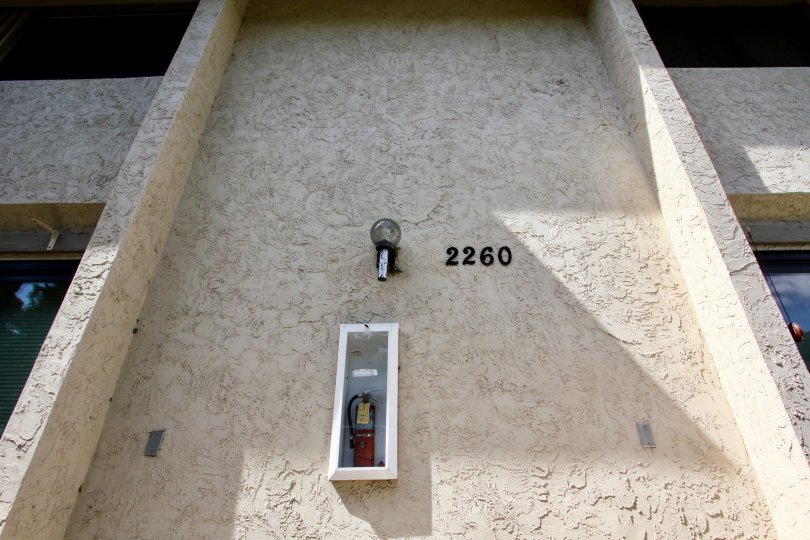 A fire extinguisher with unit number on the wall of Worden Street Condos community.