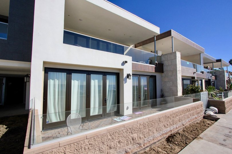 Aegea, Oceanside, California, blue sky, brown window