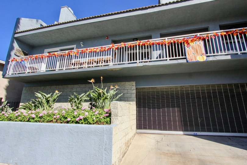 Bluewater, Oceanside, California, grey building, balcony