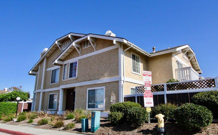 Carefree Village, Oceanside, California, blue sky, trimmed bushes