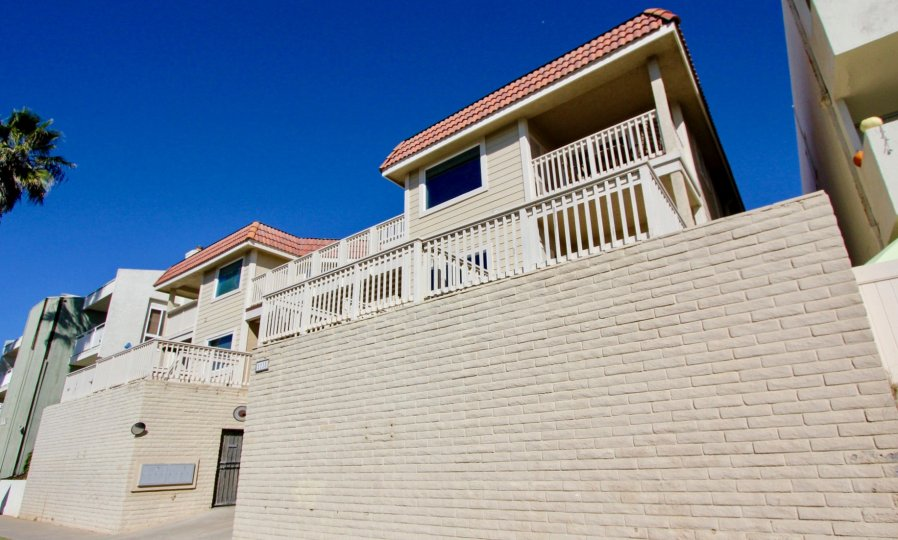 Casa Vallerta, Oceanside, California, bright blue sky, balcony