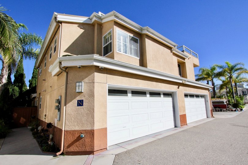 A brown residential building with two garages in Eaton Court in Oceanside California