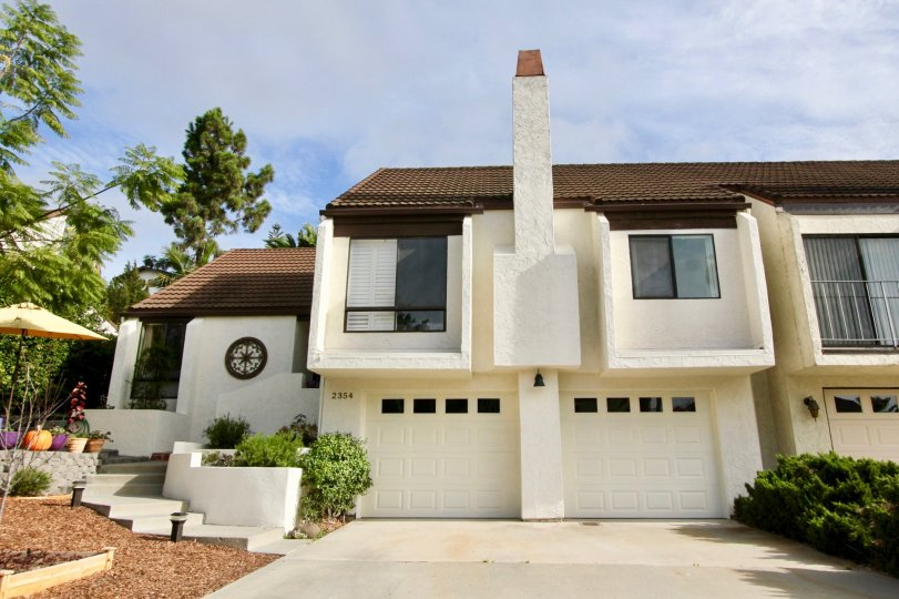 House with double garage and chimney in El Camino Villa, Oceanside, California