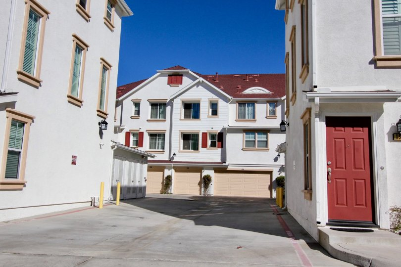 An parking area with red doors and roofs at Harbor Cliff