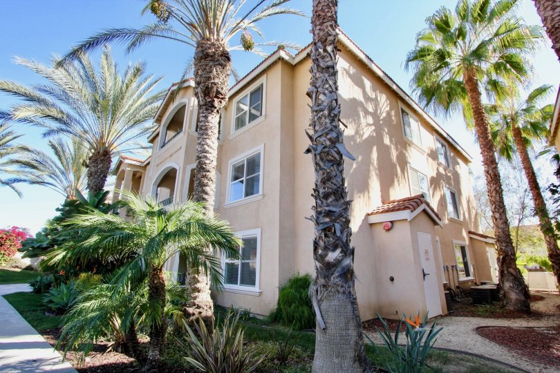 Plenty of palms and sunny skies at :a Costa Villas in Oceanside, California
