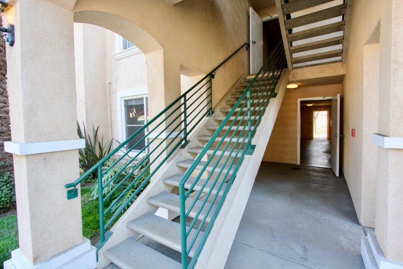 A small yard by stairs leading to a unit in La Costa Villas in Oceanside, CA