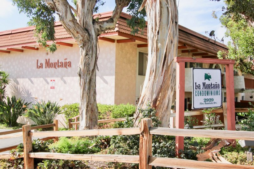 Spanish influenced condominium housing with premium landscaping at La Montana in Oceanside, CA