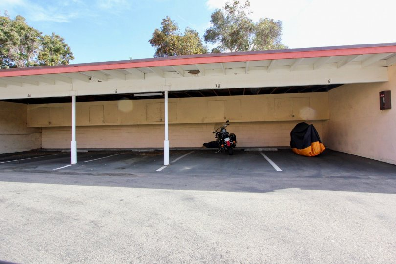 Motorcycles under the covered parking at La Montana in Oceanside, CA