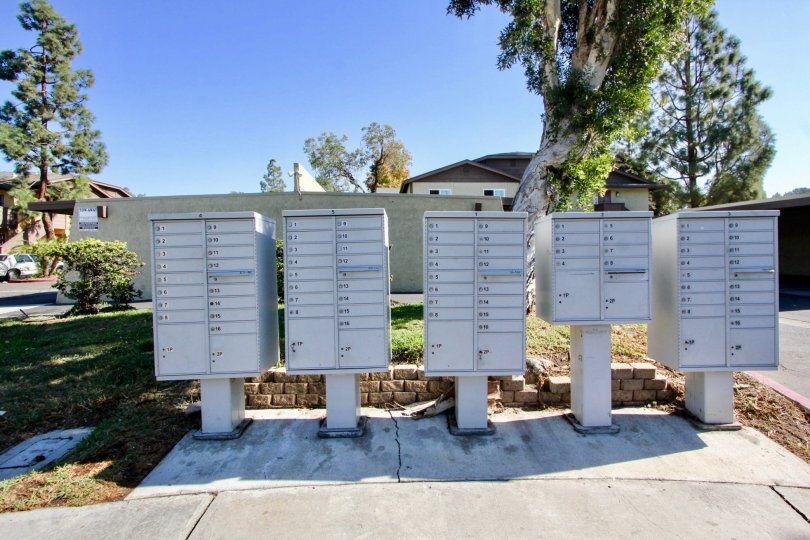In the lakeshore villas Community white mailboxes line the sidewalk.