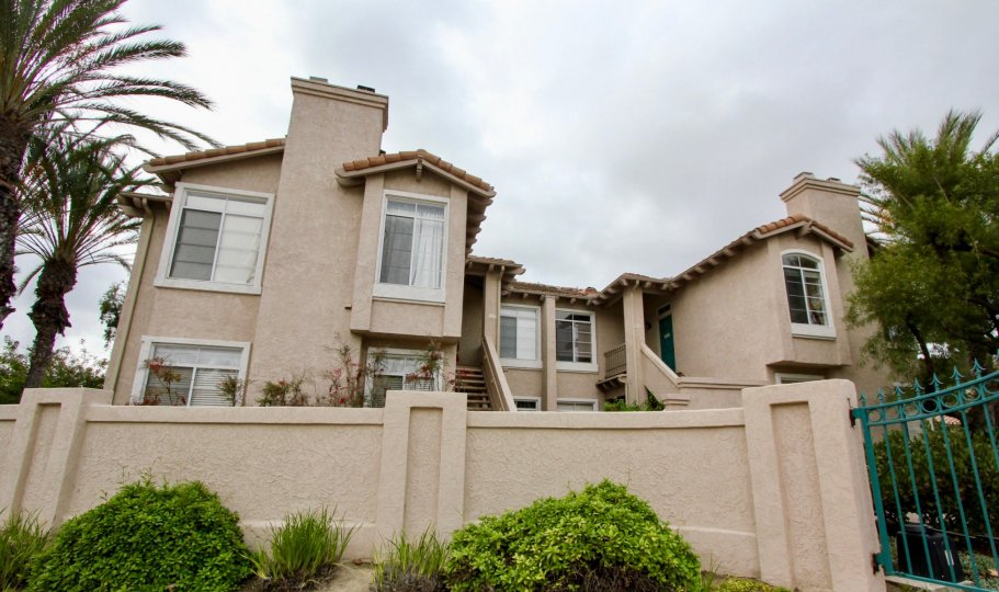 Condo town homes behind a security wall at Lomas De Oro in Oceanside CA