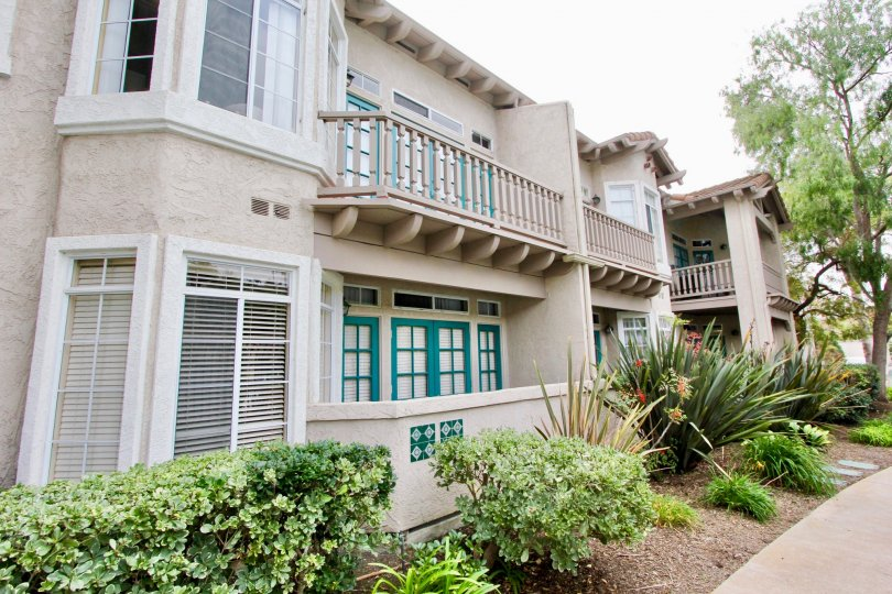Two story light brown building with brown railing in Oceanside CA at Lomas De Oro