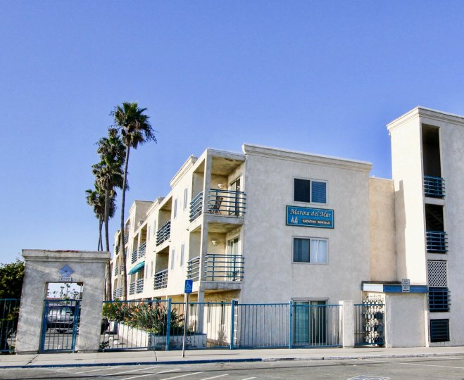 Street view of the building with blue color compound gate in Marina Del Mar