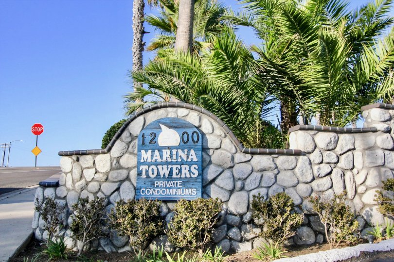 A look at the beautiful landscaping marking the main entrance to the Marina Towers Condominiums In Oceanside, CA