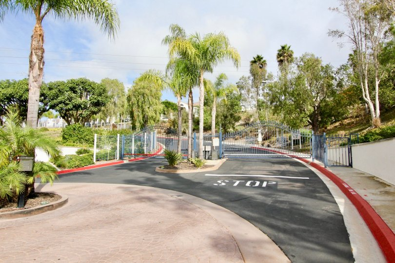 A gated community with entrance with a STOP signal showing both Entrance and Exit at Mission Del Oro